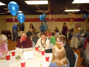 Guests eating and fellowshipping. Can you see that the balloons are attached to pictures?